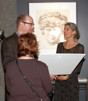Paul S. Diette and Wendy Artin in front of watercolor of Antinoüs during the opening of Stone From Delphi